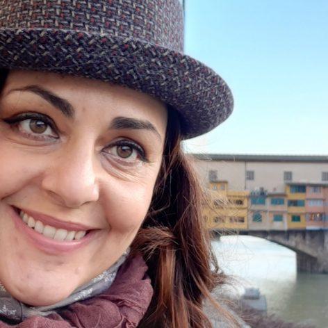 Silvia next to Ponte Vecchio, Florence, Italy.